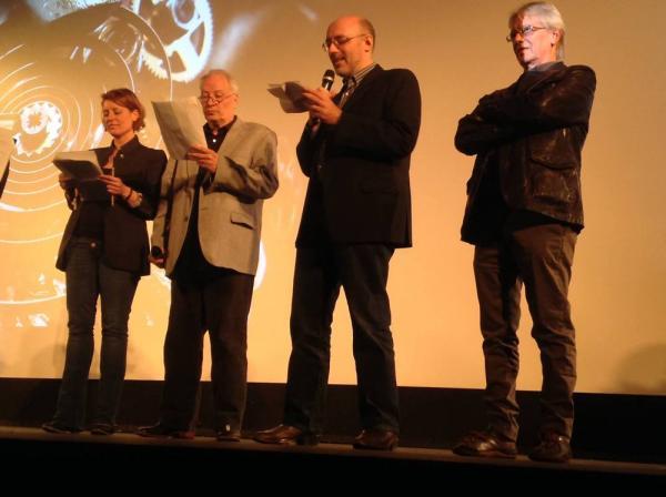 La giuria annuncia il vincitore del premio Asteroide. Da destra Georges Demote, Silvio Sosio (col microfono), Joe Lansdale.