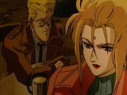 Battle Angel Alita: l'incontro in un locale tra il dottor Ido (seduto sulla sinistra) e Chiren (a destra).