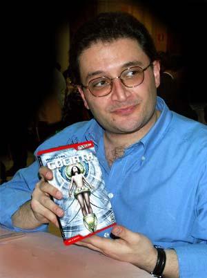 """Alberto Cola presenta il suo libro. In realtà nella foto originale, modificata poi a computer, esibiva una bottiglia di vino """"Passerina del Frusinate""""..."""