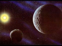 Plutone e il suo satellite Caronte in una rappresentazione artistica
