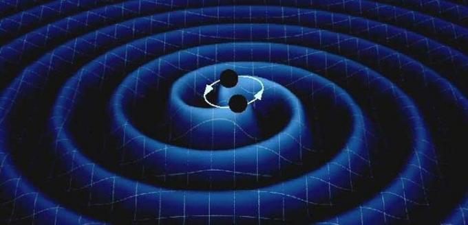 Rappresentazione artistica di un sistema di due stelle di neutroni in rotazione che perdono energia a causa dell'emissione di onde gravitazionali. (Fonte Media INAF)